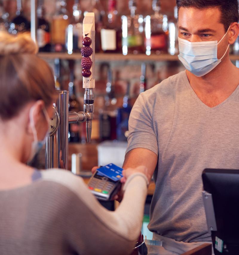 female-customer-wearing-mask-in-bar-making-contact-XLV78JT 1